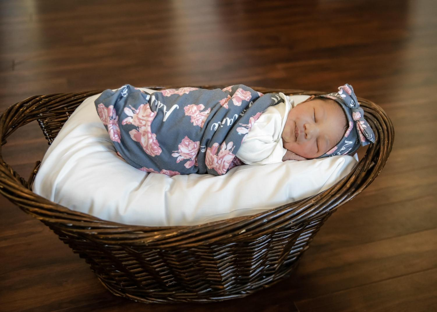 BUNDLE OF JOY: Mr. Baker, Community School assistant principal, shared with the Inlet Grove family his new family addition, Adelaide Grace Baker, born Oct. 14.