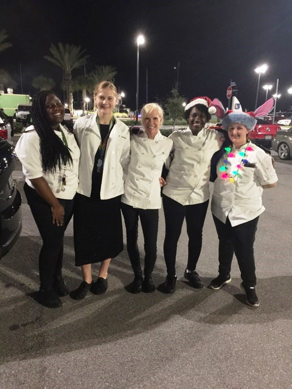 'TIS THE SEASON: Culinary students including Chef Newman from left to right: Britney Campbell, Ruth Ann Kalchik, Tia Daniel, Dakota Sands, and Jahnel Jones