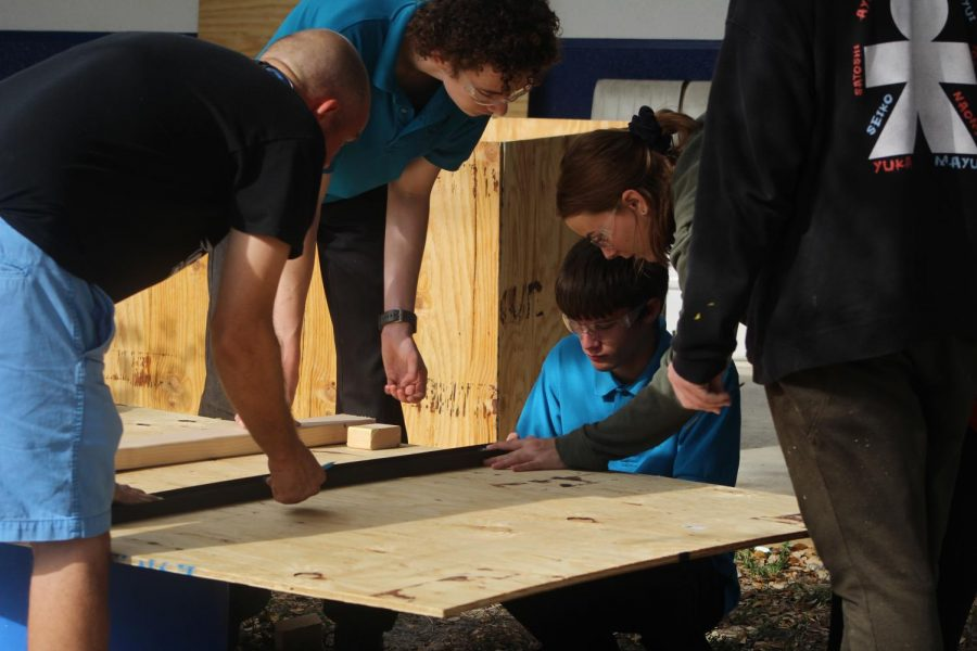 BOX IN THE MAKING: Mr. Rice, Marine Technology teacher and his students are currently building a box for the athletic director to store stuff in.