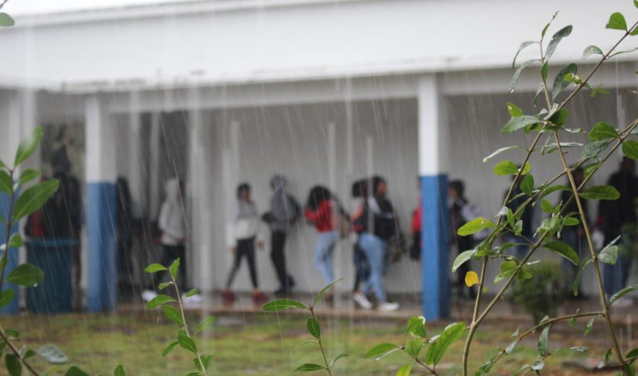 HAULING HURRICANES: Students bustle through the halls to their destinations at the beginning of lunch as the storm picks up.