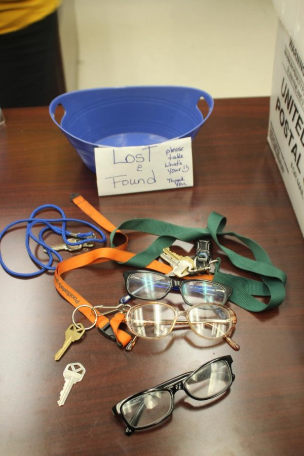 FOUND IT: In the front office, a new lost and found basket can be sorted through for misplaced items.