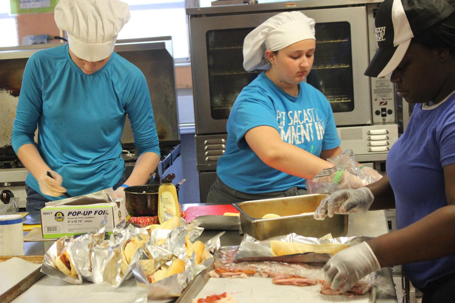 EMPTY STOMACHS:  Culinary students from period 1 and 2 prepared and organized  48 lunch plates for teachers and staff.