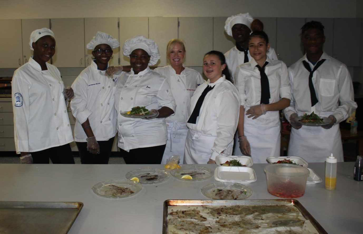 BE OUR GUEST: Chef Newman and her Culinary Academy students prepared a meal for the monthly Career Advisory Board Meeting on March 27.
