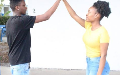 DOWN LOW: You have all day to show off your  and hand shakes, because its National High Five Day.Students (left to right) Johnathon Hunter and Hannah Snow are showing off theirs for today.