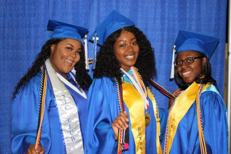 HELLO WORLD: Tears were shed as hugs were being given to the Class of 2019 as they walked the stage May 16, at the South Florida Fair Grounds Expo Center. Before the ceremony English Teachers, Ms. Mathias and Mrs. Cartwright prepped the seniors on how to stand, walk and conduct themselves throughout the event. Senior Class President Zenia Topps looked back on the highlights of her four years with her fellow classmates, keynote speaker and former Inlet Grove teacher Mr. Graham spoke on how to value this moment and Valedictorian Robelle Jean gave an inspirational speech. From left, Flolaine Francois, Tatyana Moise and Ruth-Ann Walker.