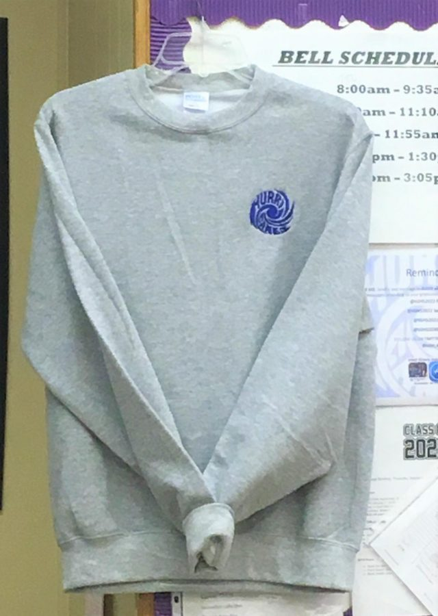 COVER UP: Because of the   dress code regulation SGA now has created a  sweatshirt for students to wear instead of their own sweaters for $15.
