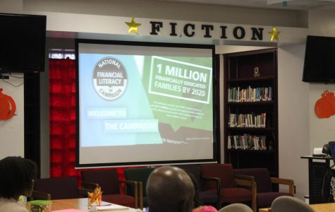 ABOUT THOSE ECONOMICS: Students, parents and teachers gathered in the Media Center on Sept. 20 for wisdom on the subject.