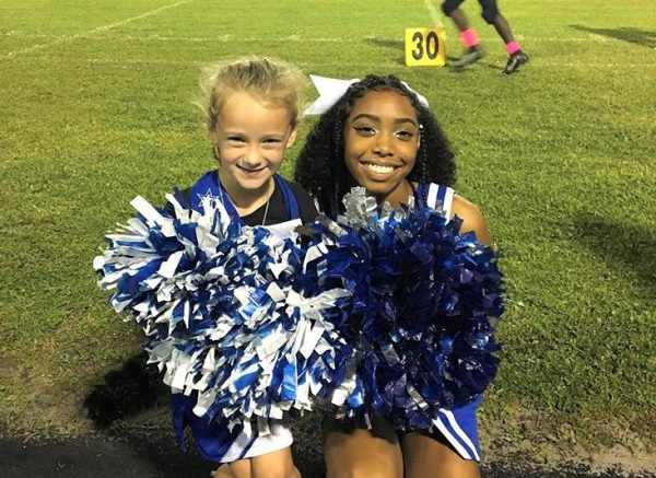 CHEER MINI ME: Gabriella Cartwright spends the night with the Lady Canes participating in their cheers.