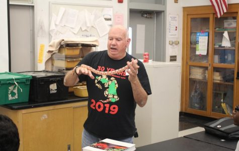 SERPENTS: Environmental Science teacher Dr. Spector invited his dad, Fred Spector on Oct. 25 to show his students different classes of snakes.