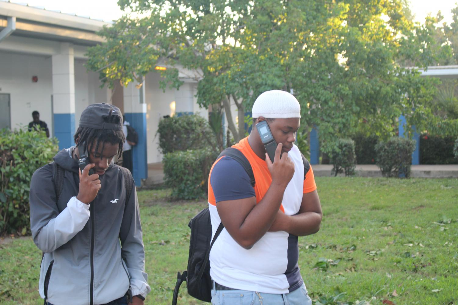 BLAST FROM THE PAST: Today at Inlet Grove it was a 90's throw back when  Maurice Law and Geovonni Wilson were using flip phones from the 90's .