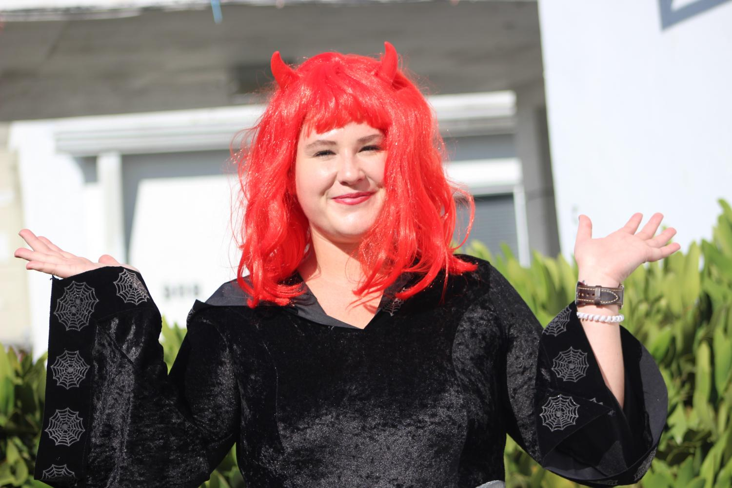 SATAN: English teacher Ms.Melbourne is dressed up as the devil for the spirit of Halloween.
