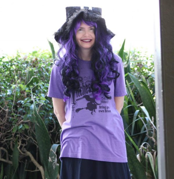 CACKLING: AP Literature and English 1 instructor, Ms. Kirkman dressed up as a witch to celebrate Halloween.
