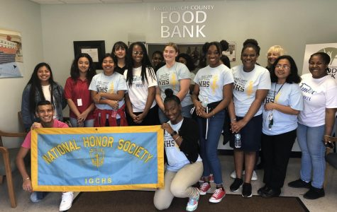 ACHIEVEMENT: Inlet Grove NHS team went to Palm beach County Food bank to help pack 320 weekend goodies for 600 identified middle school students of SDPBC and broke a record of 1.5 hrs to put things in the bags.