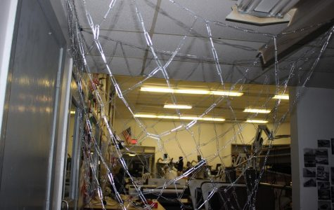 CHAIN CITY: Pre- architecture instructor Mr. Lambaz and his students designed a net out of paperclips in his class.
