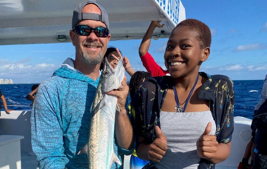 EXPLORING FOR FUN: Mr. Rice accompanies his students in the Adventure Club on a fishing field trip and celebrates Stacey Paul's, birthday, a student in the Maritime Academy.