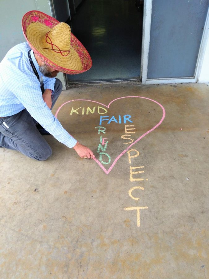 SPREADING+LOVE+THROUGH+CHALK%3A+Pre-Architecture+instructor%2C+Mr.+Lambaz%2C+drew+a+heart+with+the+words+kind%2C+friends%2C+fair+and+respect+in+front+of+his+door+using+different+color+chalk+for+Anti+Bullying+Day+on+Feb.+26.