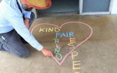 SPREADING LOVE THROUGH CHALK: Pre-Architecture instructor, Mr. Lambaz, drew a heart with the words kind, friends, fair and respect in front of his door using different color chalk for Anti Bullying Day on Feb. 26.