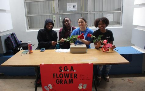 BE MINE: SGA director Mrs. Pietenza accompanies students Jalen Giles, Yardine Chocetene, and Alyssa Stephens while selling Valentine's Day flower grams to students.