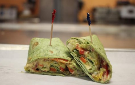 EAT THE RAINBOW: Today's vegetarian option for Teacher Lunches was a veggie wrap made with carrots, sweet peppers, avocado, cucumbers, and hummus, all wrapped up in a spinach tortilla.