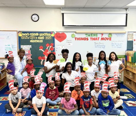 READING CELEBRATION: Ms. Cange and the Goal Chasers club attended West Riviera Elementary school to read books to the students in honor of Dr. Seuss Birthday.