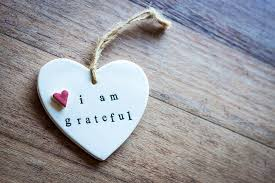 "THE FORMULA TO APPRECIATION: Here showcases a key chain quoting,"" I am grateful."""