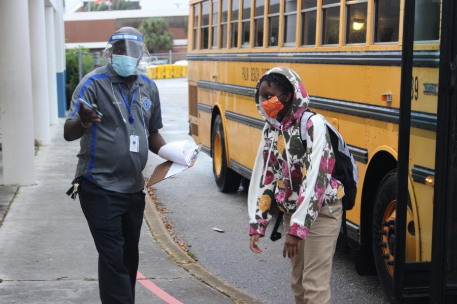 NEW NORMAL: Students, teachers, and administrators take the proper precautions as students return back to school physically to ensure that everyone is safe.