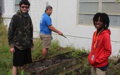 HELPING HANDS: Ethan Appleby and his friend(left) assisted Xain Lawracy with the school's garden.