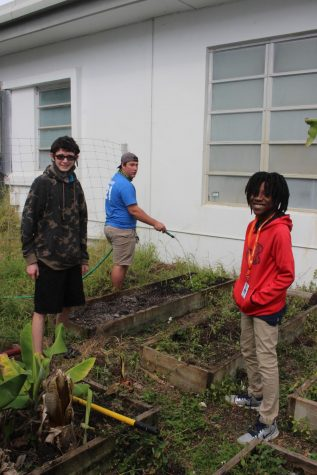HELPING HANDS: Ethan Appleby and his friend(left) assisted Xain Lawracy with the school