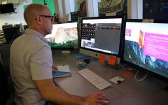 WORKING HARD: TV & Film instructor Mr. Goldstein manages his class with three monitors at his desk.