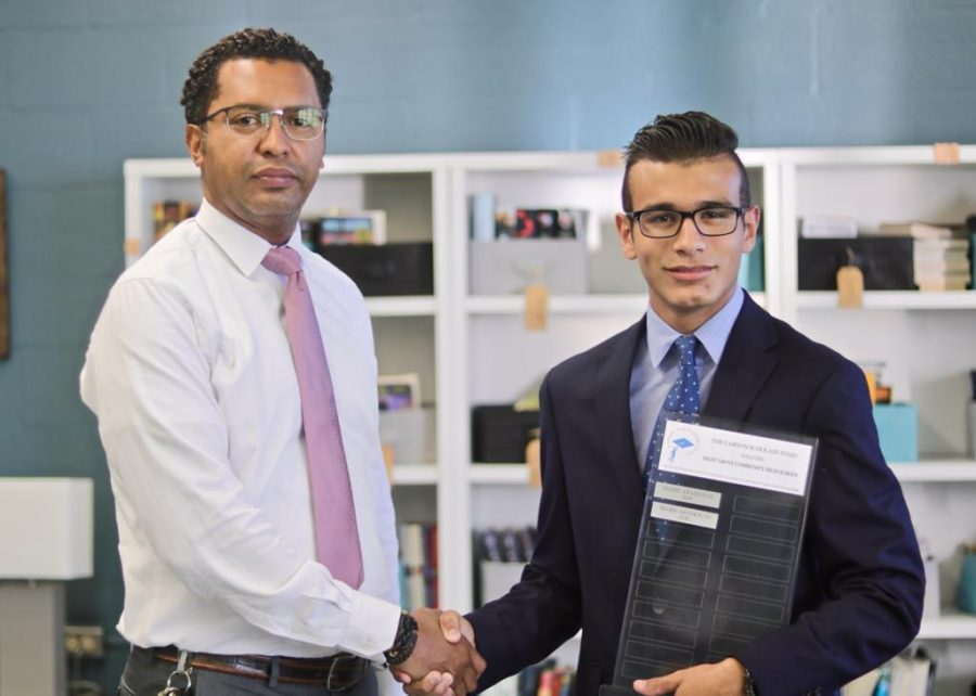 CONGRATULATIONS: Gabriel Gerig and Principal Francisco Lopez received an award for an accomplishment in 2021.