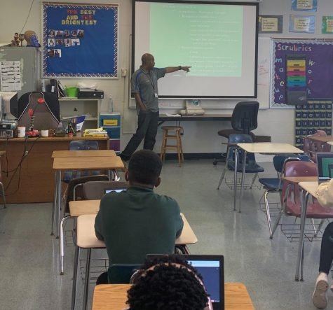 EDUCATE: Mr. Sutton giving a lecture to his second period class. The World History teacher said he hopes students leave his class with more understanding of themselves and the world around them.