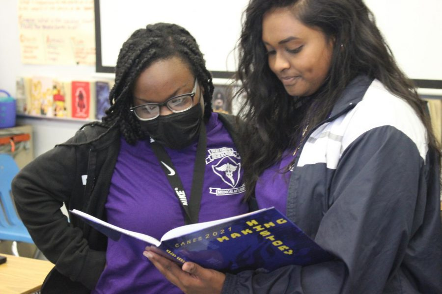 OPEN: The Seniors and teachers unboxed the yearbook for 2020- 2021 school year.