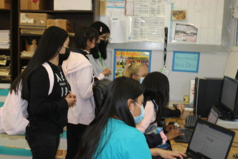 NEWBIES IN THE NEWSROOM: Editor chief, Sephora Charles shows the staff the basics.