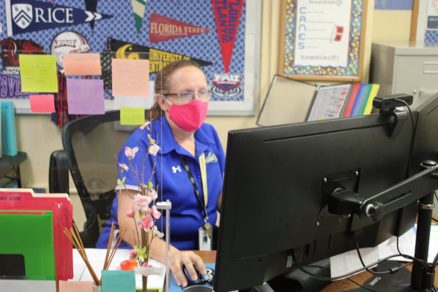HARD AT WORK: Ms. Bonikowski is the administrative secretary to Mrs. Latson.